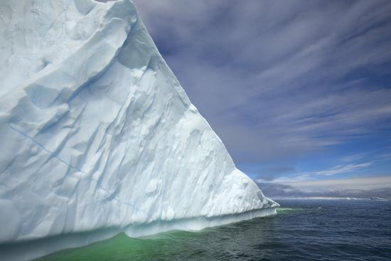 momatiuk-eastcott-massive-iceberg-floating-in-sea