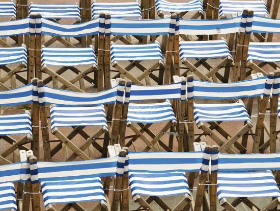 nadia-isakova-rows-of-traditional-blue-and-white-deckchairs-eastbourne-sussex-uk