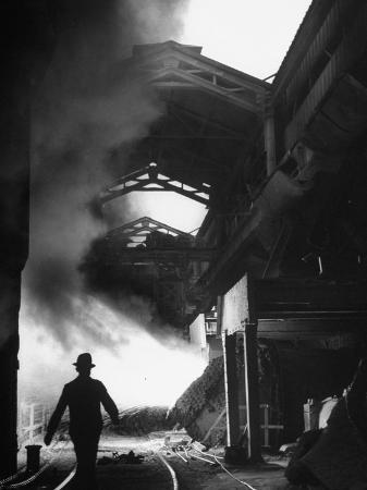 nat-farbman-man-walking-in-the-smokey-steel-mill