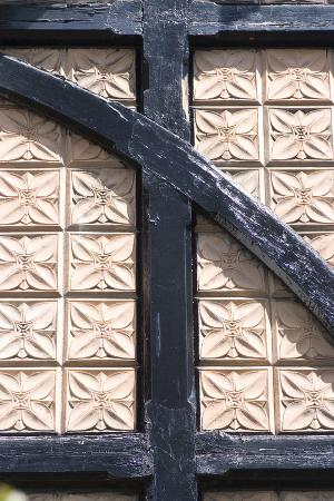 natalie-tepper-plaster-patterned-tiles-in-a-wood-timber-frame-on-a-residential-building