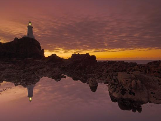 neale-clarke-dramatic-sunset-and-low-tide-corbiere-lighthouse-st-ouens-jersey-channel-islands-uk