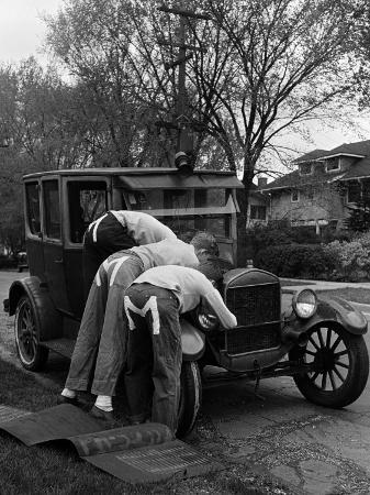 nina-leen-teenaged-boys-working-on-a-1927-ford-model-t