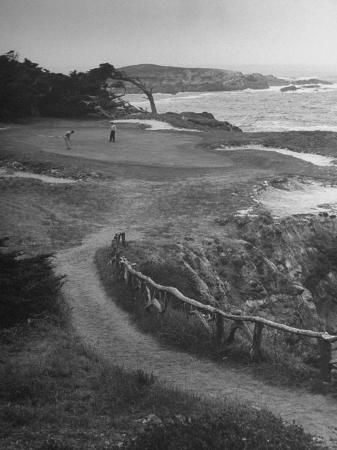 nina-leen-two-golfers-playing-on-a-putting-green-at-pebble-beach-golf-course