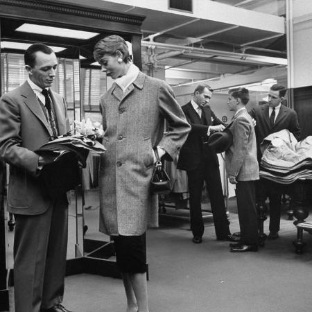 nina-leen-woman-shopping-in-brooks-brothers-wearing-men-s-tweed-topcoat
