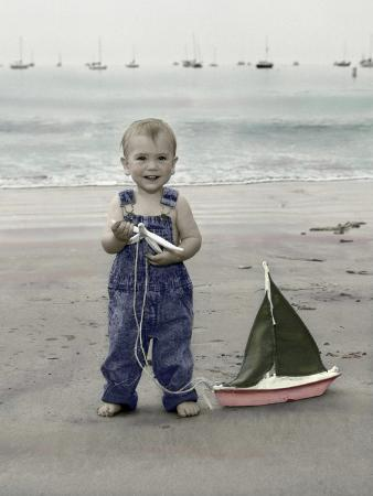 nora-hernandez-little-kid-on-beach-with-toy-sailboat