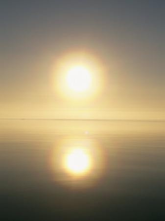 norbert-rosing-the-sun-casts-its-reflection-upon-the-water