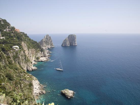 olivieri-oliviero-capri-with-the-famous-faraglioni-rocks-on-the-back-ground-capri-bay-of-naples-italy