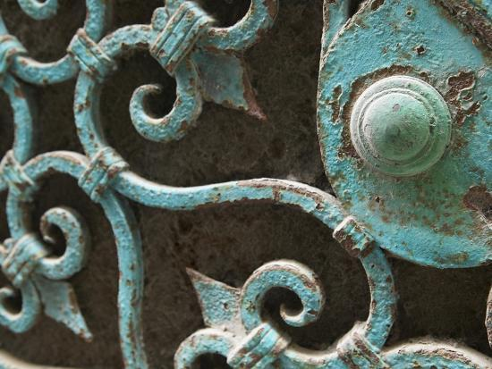 ornate-metal-gate-with-doorknob