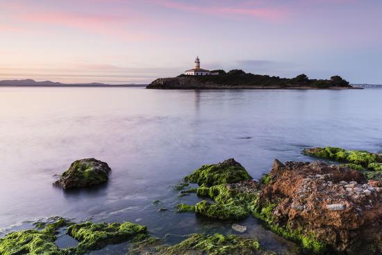 p-kaczynski-view-over-the-sea-on-the-lighthouse-of-the-island-illa-d-alcanada-daybreak-alcanada