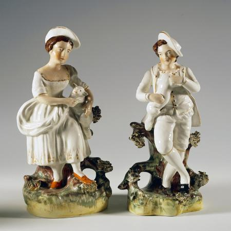 pair-of-shepherds-with-lambs-in-their-arms