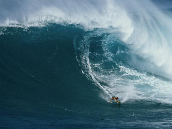 patrick-mcfeeley-a-surfer-rides-a-powerful-wave-off-the-north-shore-of-maui-island