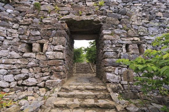 paul-dymond-the-stone-entrance-to-nakijin-castle-a-14th-century-castle-in-okinawa-japan