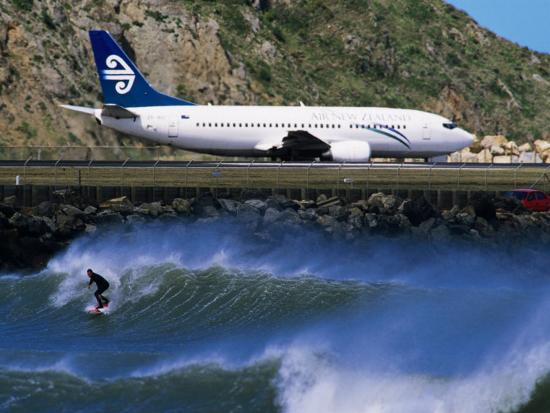 paul-kennedy-surfer-in-the-corner-next-to-airport-runway-lyall-bay-wellington-new-zealand