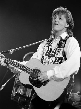 paul-mccartney-playing-guitar-on-stage