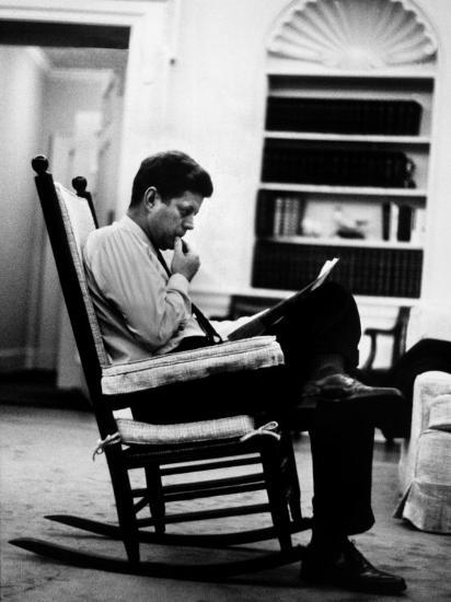 President John F Kennedy Sitting Alone Thoughtfully In His Rocking Chair The Oval Office