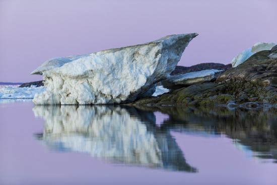paul-souders-canada-nunavut-iceberg-reflected-in-calm-waters-at-dusk