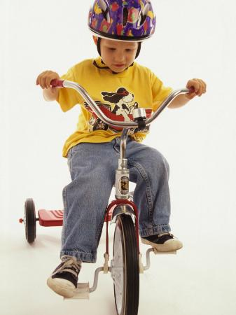 paul-sutton-4-year-old-boy-posing-on-his-tricycle-new-york-new-york-usa