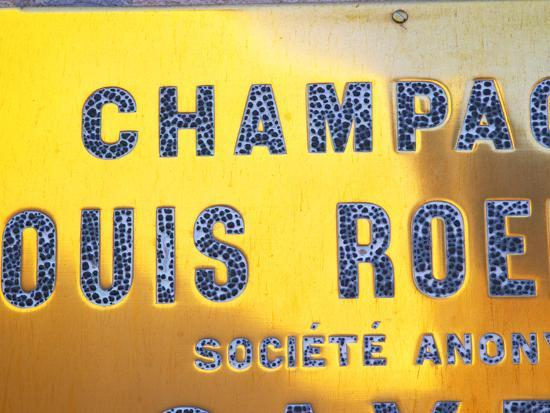 per-karlsson-polished-brass-sign-at-winery-of-louis-roederer-reims-champagne-marne-ardennes-france