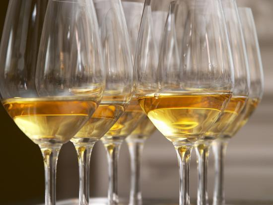per-karlsson-wine-tasting-glasses-with-golden-sweet-white-wine-from-uroulat-jurancon-charles-hours-france
