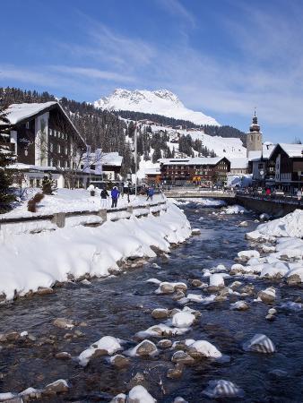 peter-barritt-river-and-village-church-lech-near-st-anton-am-arlberg-in-winter-snow-austrian-alps