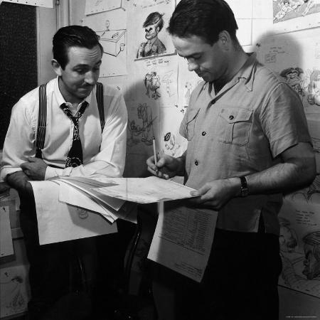 peter-stackpole-director-walt-disney-looking-over-sketches-from-his-latest-picture-pinocchio