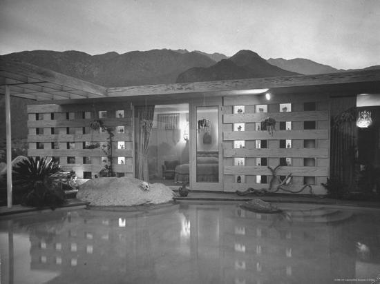peter-stackpole-swimming-pool-at-industrial-designer-raymond-loewy-s-home-running-from-outdoors-into-living-room