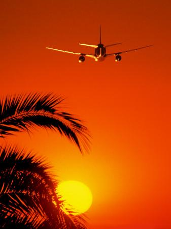 peter-walton-airplane-flying-over-sunrise