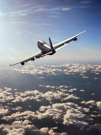 peter-walton-airplane-flying-through-clouds