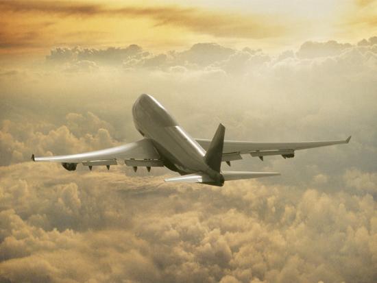 peter-walton-jumbo-jet-above-clouds-at-35-000-feet