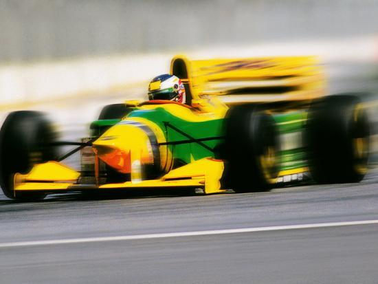 peter-walton-yellow-race-car-in-motion