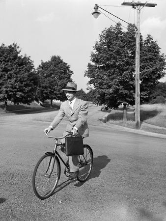 philip-gendreau-business-man-riding-bicycle