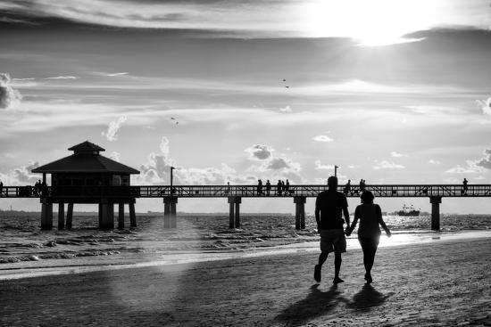 philippe-hugonnard-loving-couple-walking-along-the-beach-at-sunset