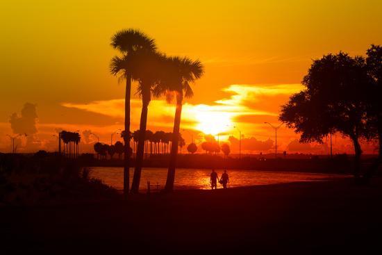 philippe-hugonnard-romantic-walk-along-the-ocean-at-sunset