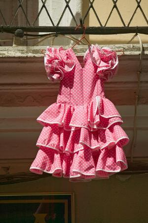 pink-flamenco-dress-for-little-girl-hangs-in-centro-old-district-of-sevilla-spain