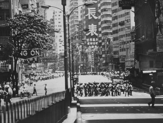police-watching-demonstrators-before-out-break-of-rioting