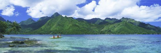 polynesian-people-rowing-a-yellow-outrigger-boat-in-the-bay-opunohu-bay-moorea-tahiti-french