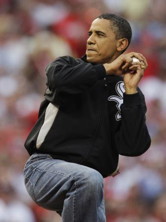 president-obama-winds-up-to-throw-out-the-first-pitch-during-the-mlb-all-star-baseball-game-in-st