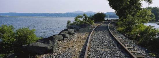 railroad-track-along-a-river-hudson-river-kingston-new-york-state-usa