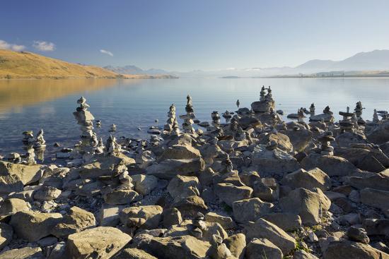 rainer-mirau-stone-dwarves-at-the-shore-of-the-lake-tekapo-canterbury-south-island-new-zealand