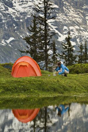 rainer-mirau-switzerland-canton-wallis-bernese-oberland-gro-e-scheidegg-woman-tent-camping-cook
