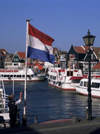 raising-the-dutch-flag-by-the-harbour-volendam-ijsselmeer-holland