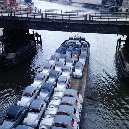 ralph-crane-low-aerials-of-citroen-cars-on-barge-in-unidentified-waterssomewhere-in-europe