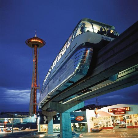 ralph-crane-monorail-at-century-21-seattle-world-s-fair-space-needle-in-background