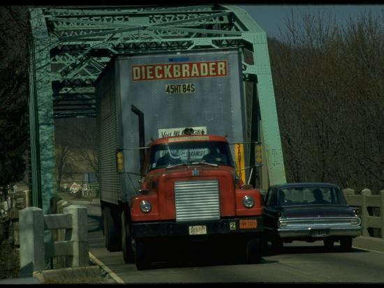 ralph-crane-tractor-trailer-truck-squeezing-by-car-on-narrow-2-lane-bridge-over-river-on-us-highway-42