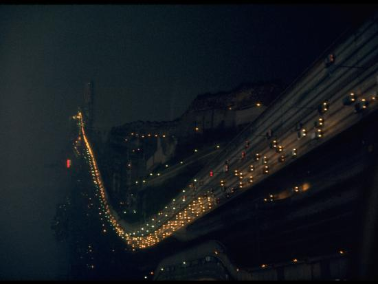 ralph-crane-west-side-highway-at-night-with-stream-of-headlights-from-heavy-traffic-near-hudson-riverfront