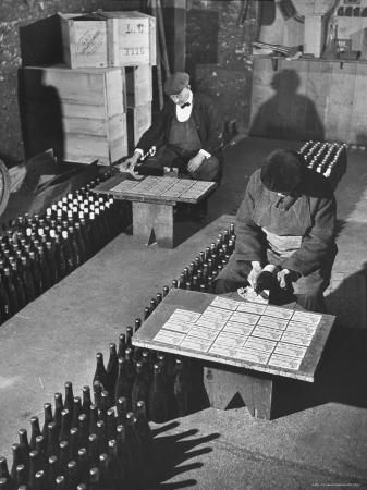 ralph-morse-men-putting-labels-on-wine-bottles