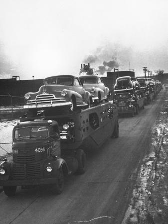 ralph-morse-newly-made-pontiacs-being-transported-on-trucks