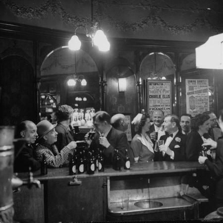 ralph-morse-patrons-drinking-and-chatting-at-the-bar-of-a-music-hall