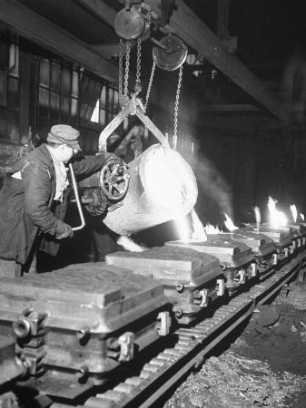 ralph-morse-worker-pouring-hot-steel-into-molds-at-auto-manufacturing-plant