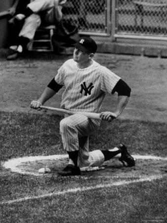 ralph-morse-yankees-outfielder-mickey-mantle-sitting-in-circle-waiting-to-bat-during-game-at-yankee-stadium